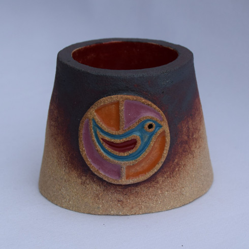 Bird Tea Light Holder made from a textured stoneware clay and coloured glazes.