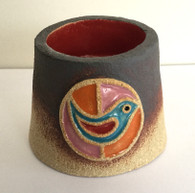 Bird Tea Light holder made from a textured stoneware clay, finished with coloured glazes and oxide.