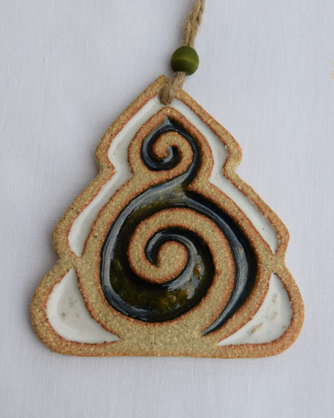 Tree decoration made from a stoneware clay and coloured glazes. Hessian string and bead added to hang. Supplied on a product card.