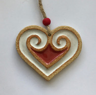 Heart decoration made from textured stoneware clay and coloured glazes. Hessian string and bead added to hang. Supplied on a product card.