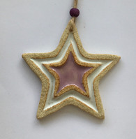 Star decoration made from a textured stoneware clay and coloured glazes. Hessian string and bead added to hang. Supplied on a product card.