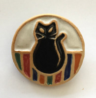 Cat brooch made from a white stoneware clay and coloured glazes. Supplied on a product card.