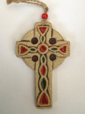 Small Celtic Cross hanging made from a textured stoneware clay and finished with glazes and oxide.