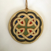 Celtic knot hanging made from a textured stoneware clay and finished with glazes and oxide. Hessian string used for hanging. Comes supplied in a gift box and with a product card.