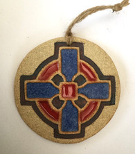 Cross Round hanging made from a textured stoneware clay and finished with glazes and oxide. Comes supplied in a gift box and with a product card.