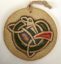 Celtic Dog Round hanging made from a textured stoneware clay and finished with glazes and oxide. Hessian string is used to hang. Supplied with a gift box and a product card.