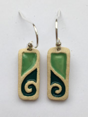 Drop earrings made from a white stoneware clay and coloured glazes. Supplied with sterling silver earwires and on a product card.