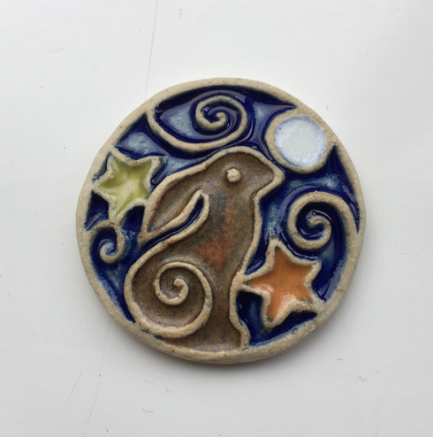 Hare brooch is handmade from a white stoneware clay and finished with glazes. Comes supplied on a card.