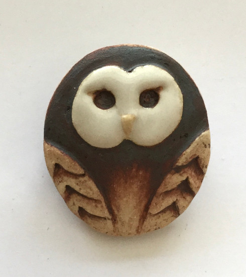 Owl brooch made from a white stoneware clay and finished with white glaze and oxide. Supplied on a product card.