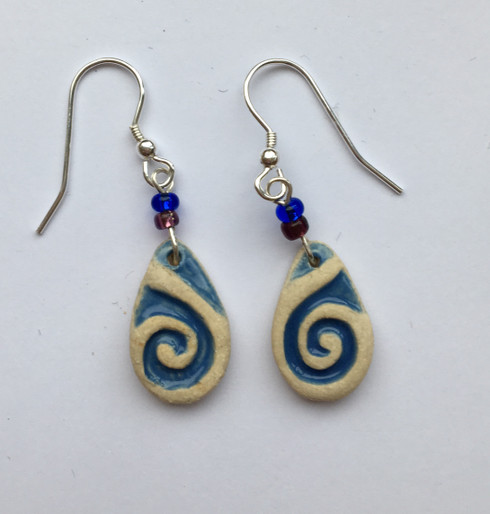 Drop earrings made from a white stoneware clay and finished with coloured glazes.  Supplied on sterling silver Earwires, on a product card.