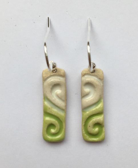 Drop earrings made from a white stoneware clay and coloured glazes. Supplied with sterling silver Earwires and on a product card