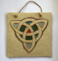 Trinity plaque made from textured stoneware clay, coloured glazes and oxide. Hessian string added to hang.