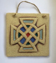 Knot plaque made from a textured stoneware clay, coloured glazes and oxide. Hessian string added to hang.
