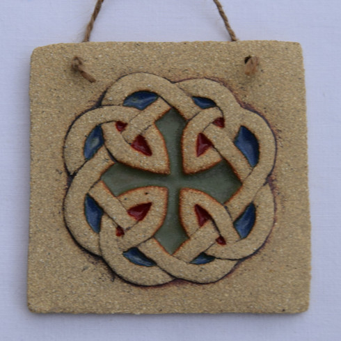 Celtic Knot Plaque made from a textured stoneware clay, coloured glazes and oxide. Hessian string added to hang.