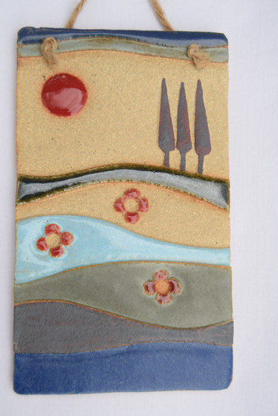 Spring Plaque made from a textured stoneware clay, coloured glazes and oxide.