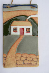 Cottage Plaque made from a textured stoneware clay, coloured glazes and oxide.