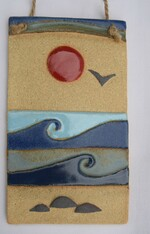 Seaside Plaque made from a textured stoneware glaze, coloured glazes and oxide.