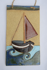 Boat Plaque made from a textured stoneware clay, coloured glazes and oxide.