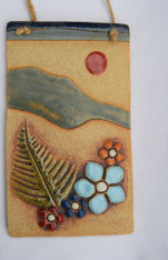 Mountain Plaque made from a textured stoneware clay, coloured glazes and oxide.