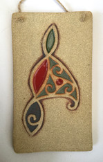 Triscele plaque made from a textured stoneware clay, coloured glazes and oxide. Supplied in gift box with a product card.