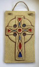 Celtic cross plaque made from a textured stoneware clay, coloured glazes and oxide. Supplied in a gift box and with a product card.