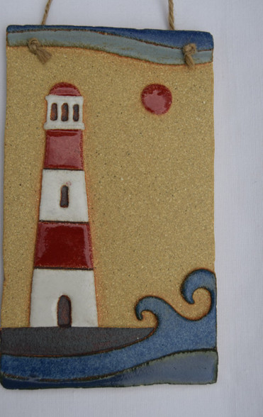 Lighthouse Plaque made from a textured stoneware clay, coloured glazes and oxide.