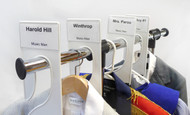 Rack dividers with Adhesive Business Card holders on garment rack.