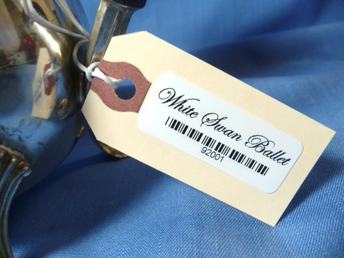 Manila tag on a tea pot with large Adhesive Inventory Label