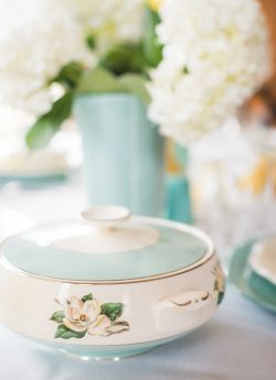 Tablescape of vintage turquoise lifetime china covered vegetable bowl with aqua pottery vase