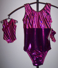 "Tank style gymnastics leotard in a beautiful MAGENTA RIBBON sparkle spandex split with a solid magenta mystique spandex - one for you and one for your 18"" doll. Free scrunchie included for you, and free headband for your doll. This doll leotard was made to fit the American Girl dolls, but will fit most similar body type 18"" dolls."