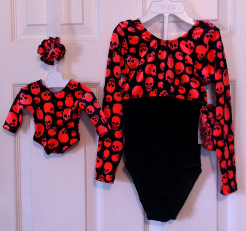 ONLY 1 AVAILABLE! Closeout long sleeve style gymnastics leotard and coordinating doll leotard in the print shown.  Free scrunchie as always!