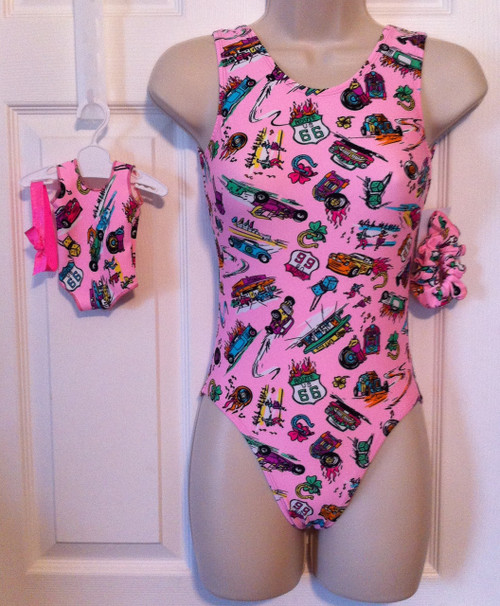 ONLY 1 AVAILABLE! Closeout tank style gymnastics leotard and coordinating doll leotard in the print shown.  Free scrunchie as always!  Due to the discount prices there are no returns or exchanges on these items.
