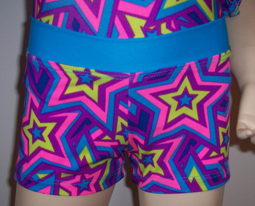 STAR CRAZED shorts with turquoise waistband.