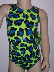 Gymnastics and/or dance leotard in a lime FRENZY spandex with rows of tiny foiled silver dots throughout.  Available in tank or racer back. Free scrunchie included.