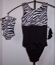 """Tank style gymnastics leotards in a ZEBRA SPARKLE spandex split with solid black spandex - one for you and one for your 18"""" doll. The doll leotard is not split, but is entirely of the ZEBRA SPARKLE spandex. Free scrunchie included for you, and free headband for your doll. This doll leotard was made to fit the American Girl dolls, but will fit most similar body type 18"""" dolls."""