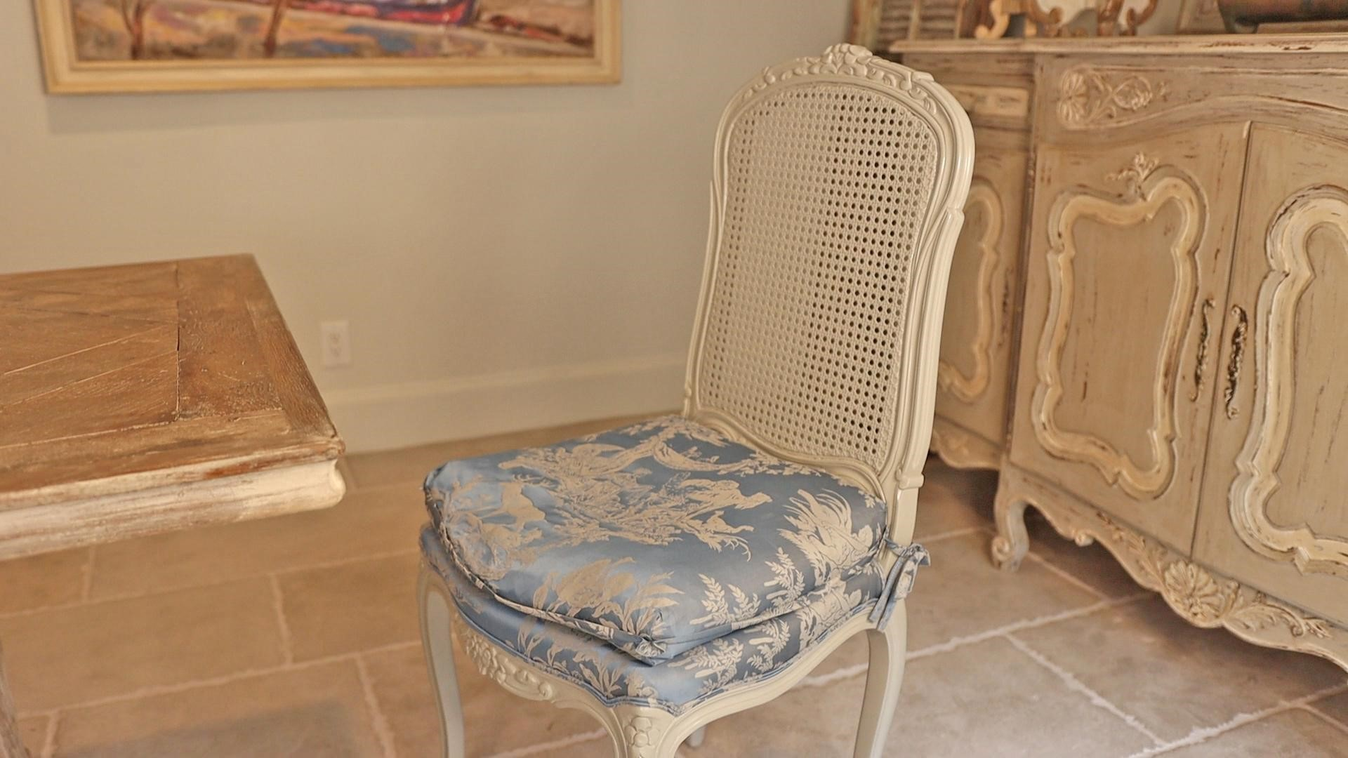 French country-style chairs in white and blue after Amtiha's chalk-finish paint project.
