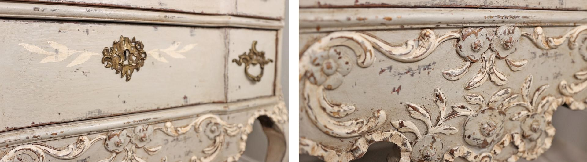 A closeup of the gorgeous scrolling details of the French nightstand after Amitha's chalk finish paint makeover to show the look of distressed paint.