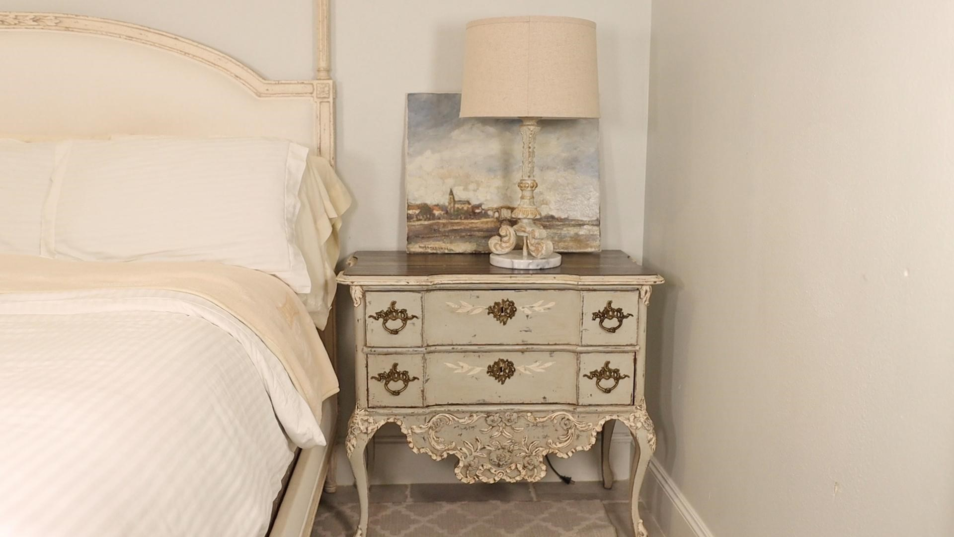 """French country nightstand called """"commode"""" by the bed with a chalk-finish paint makeover by Amitha"""