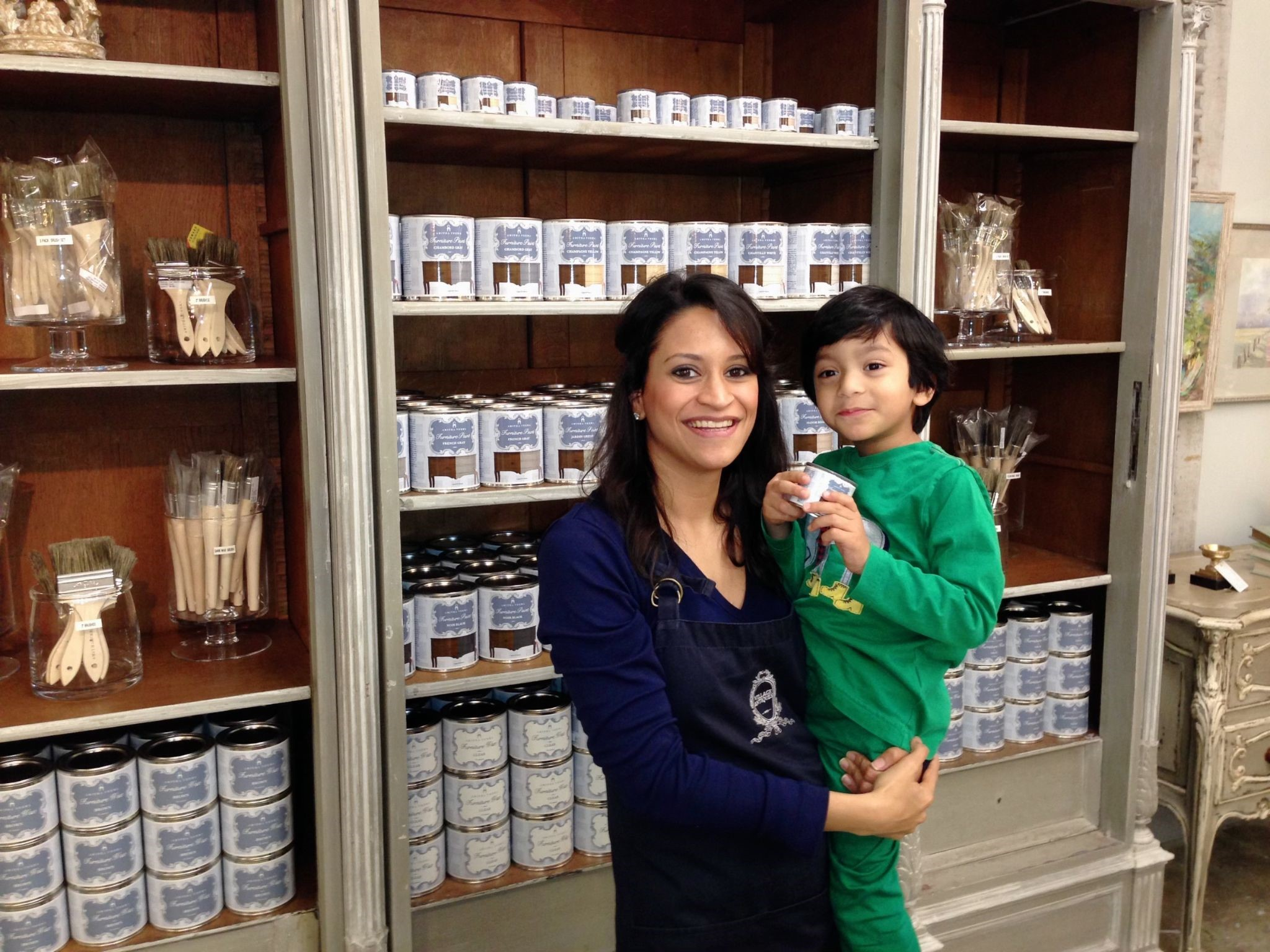 Amitha and son Rohan, in front of the new Amitha Chalk Paint shelves after launch at an antique store in Houston, Village Antiques