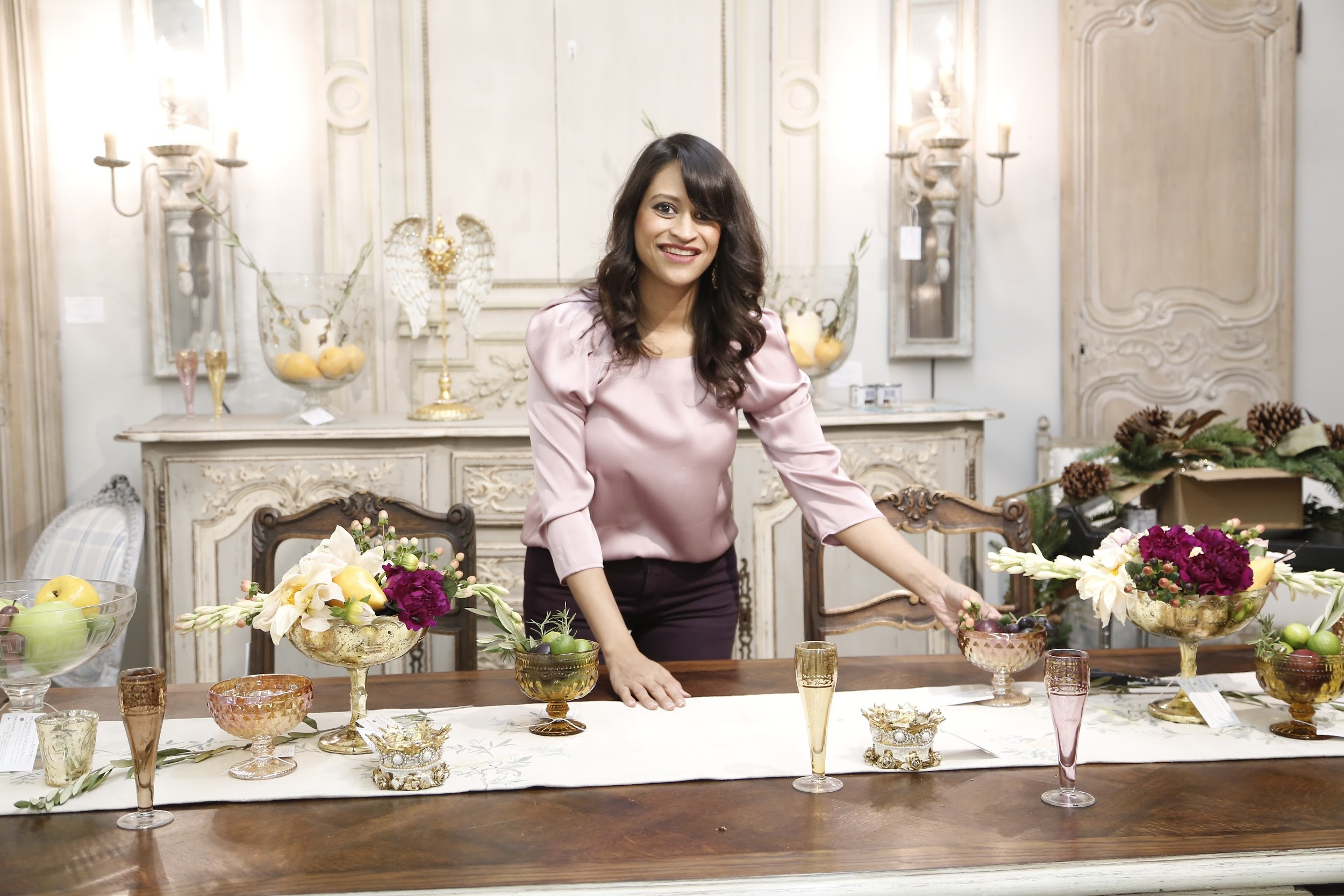 Amitha styling a tablescape at her Houston shop, Village Antiques