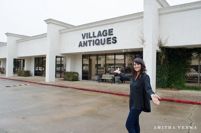 Amitha proudly standing outside of Village Antiques, an Antique Store and Farmhouse Furniture Store in Houston, Texas.