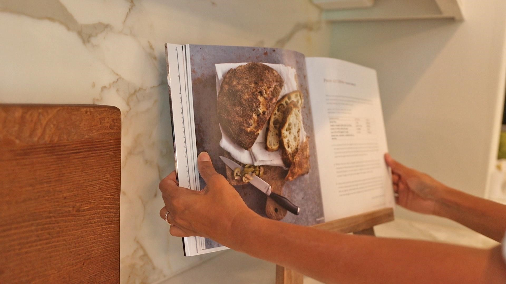 Propping a beautiful bread baking recipe book to display on an easel