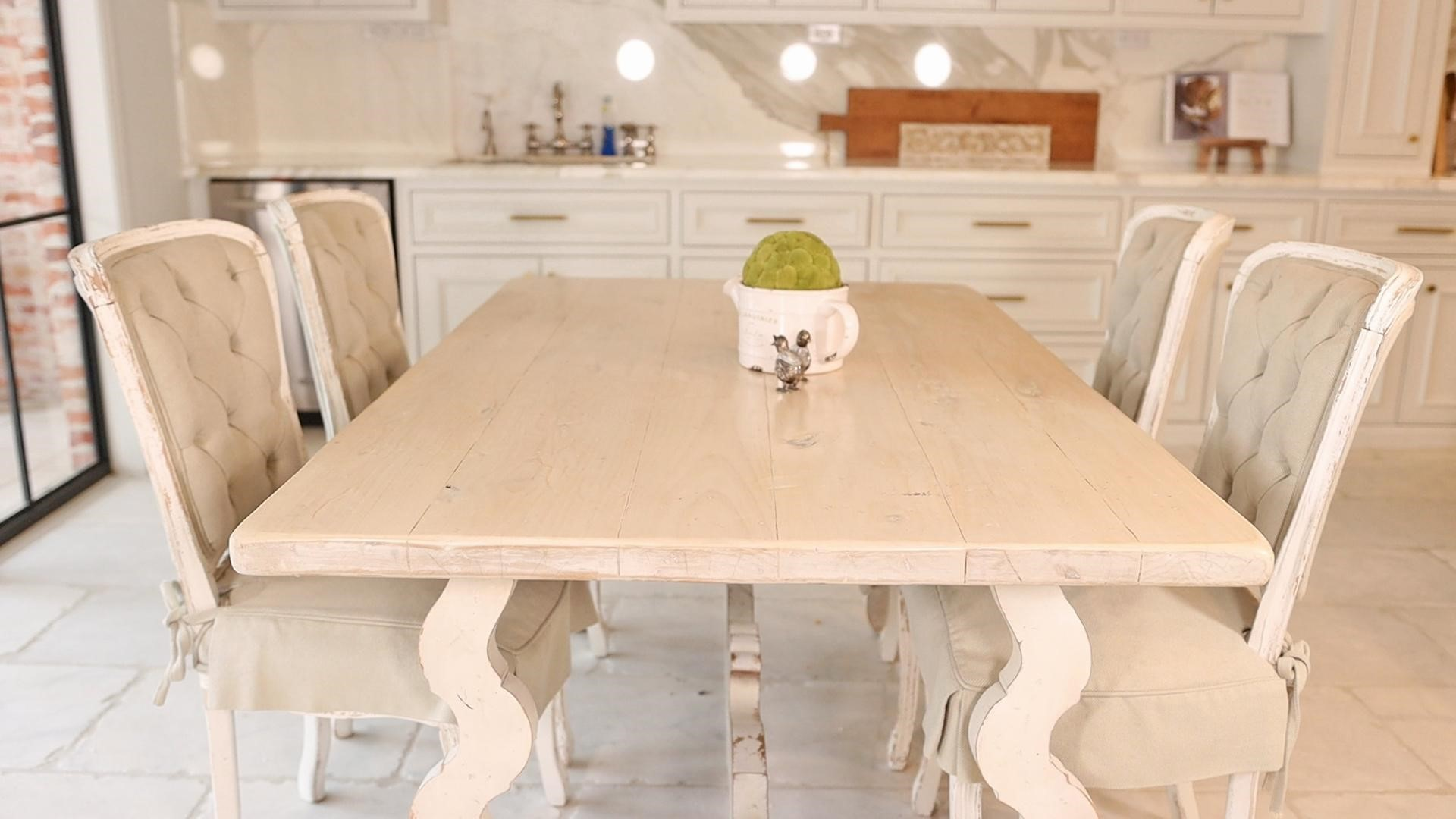 Lightweight rectangular table and heavier chairs contrast in this breakfast nook