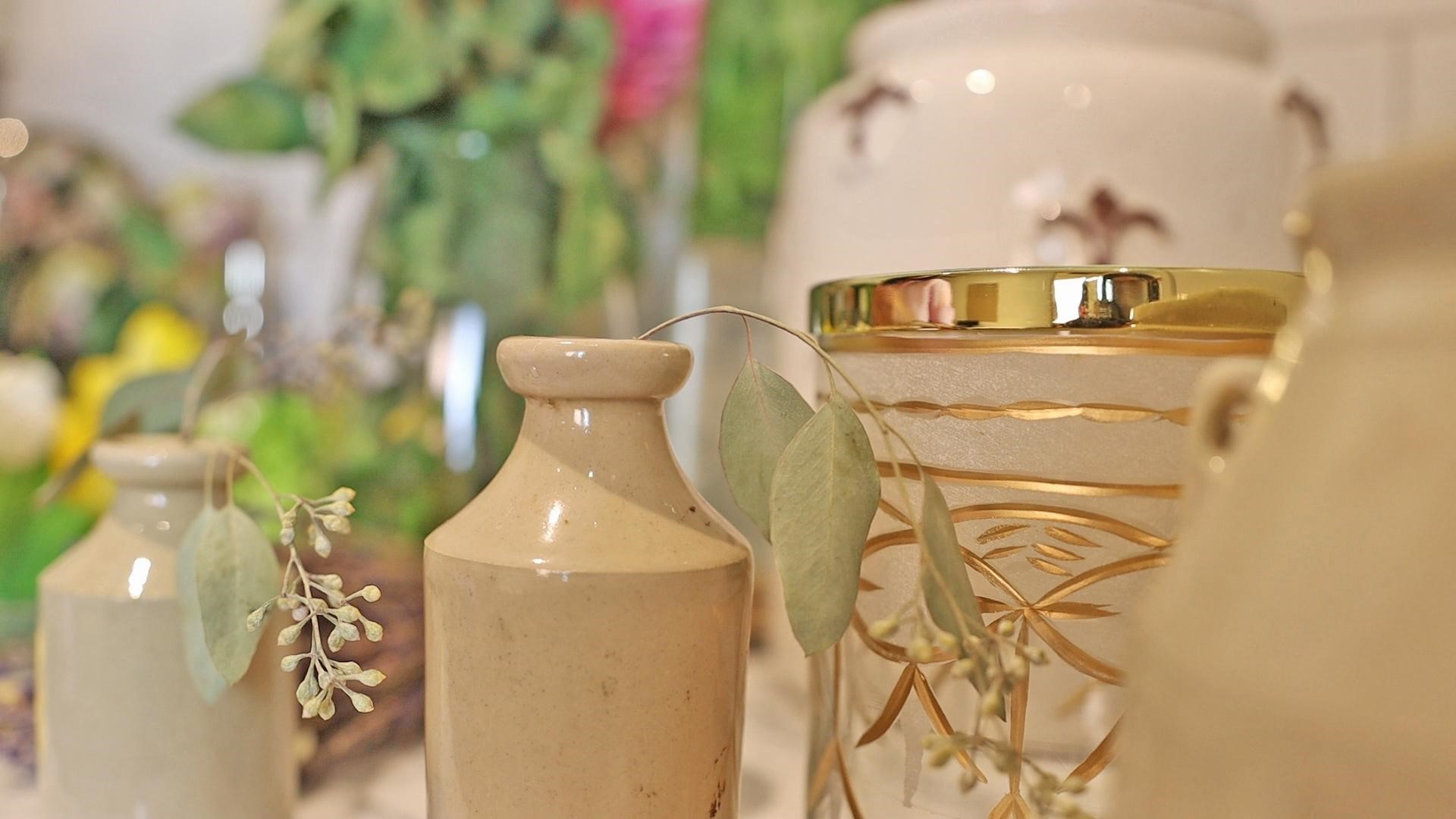 Adding eucalyptus stems in small vases for an effortless, rustic feel