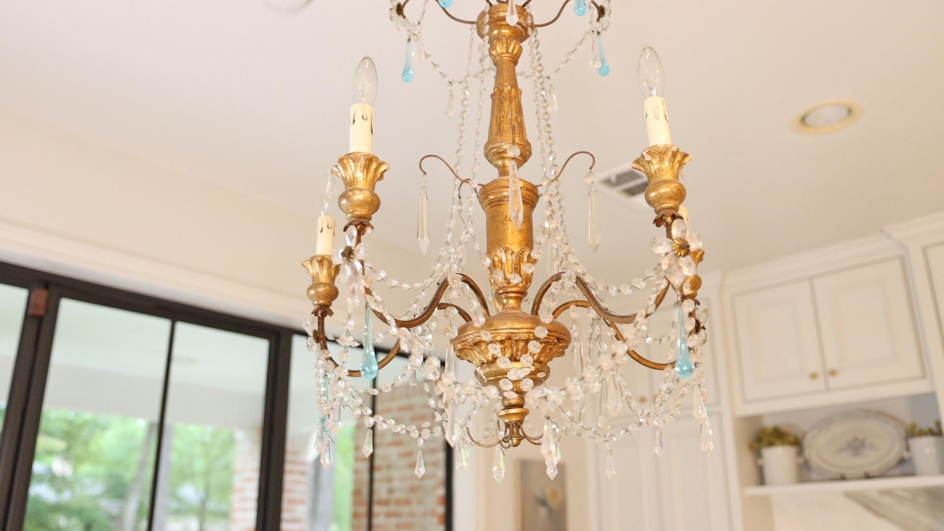 Gold and crystal small-sized French country decor chandelier to elevate a casual farmhouse dining nook.