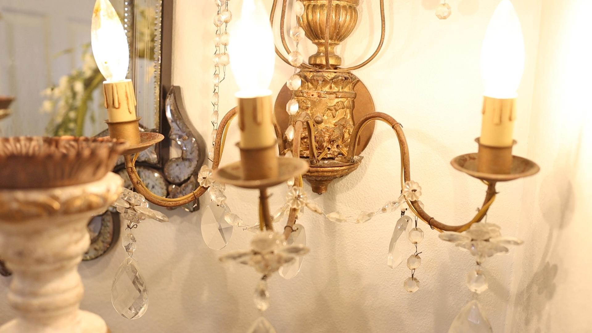 Add glam to your hallways with gilt french country decor wall sconces to add interest and reflect light.