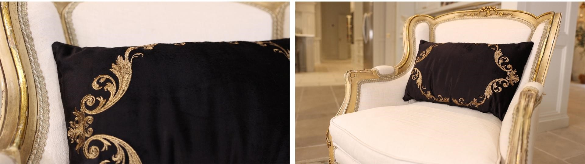 Black velvet and gold detailing french country decor throw pillow on a white and gold armchair