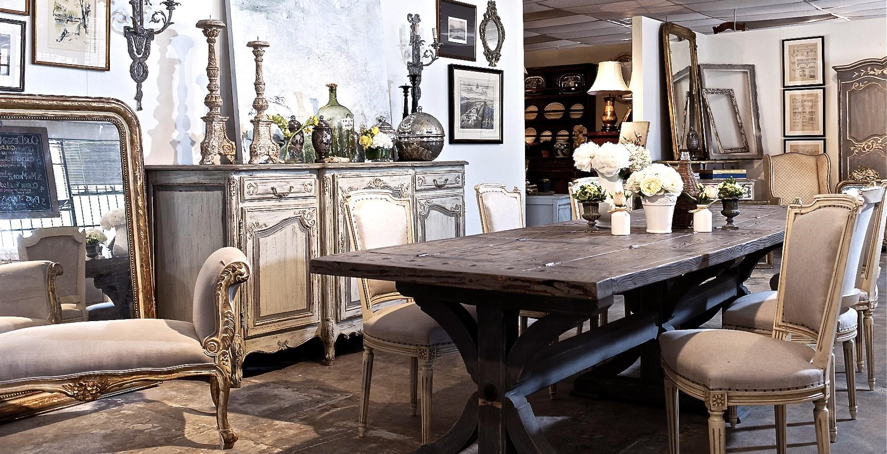 A dining room collection of rustic, modern, and industrial style furniture all mixed together to create the French cottage style.