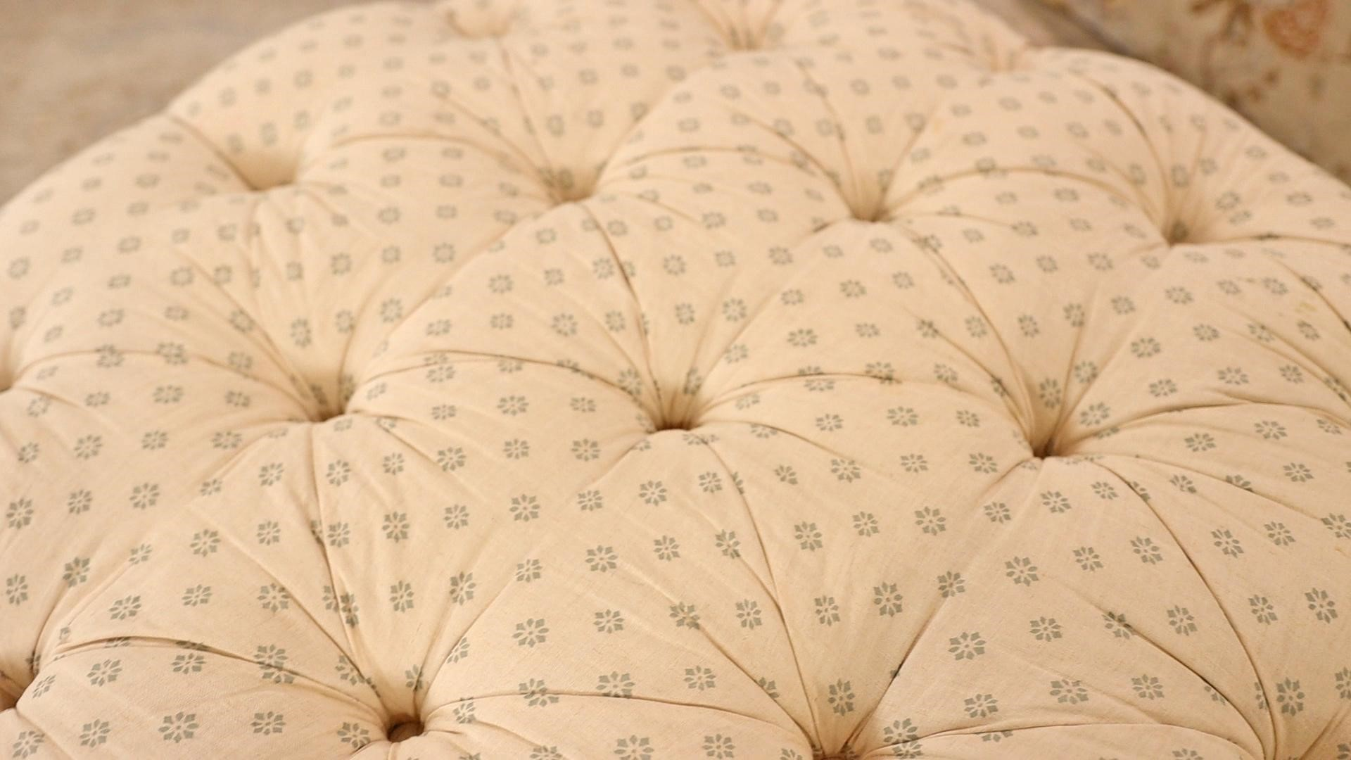 Looking at the small print fabric details of cream and blue on Amitha's french country furniture ottoman/ footstool.