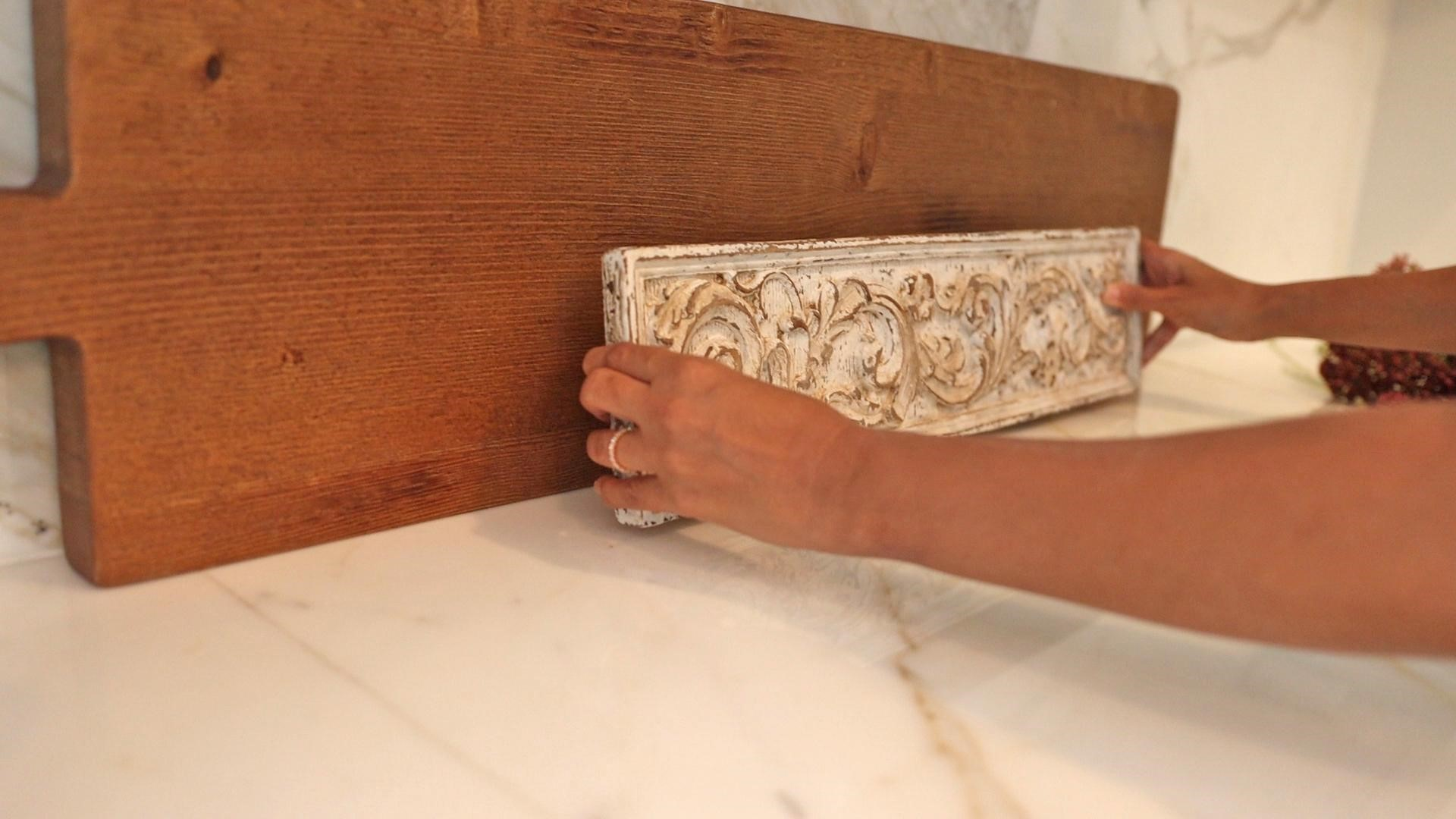Large wooden bread board next to the short, long decorative white paint chipped panel